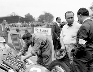 Piero Taruffi in the pits at Monza in a Tipo 158.