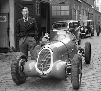 Richard Seaman with Ruesch's Tipo B (chassis number 50013) in his London mews.